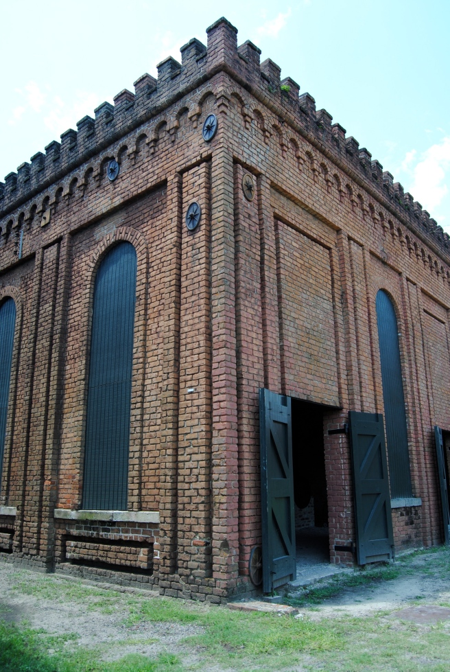 """Engine house and boiler room: """"Completed in 1855, this building housed a boiler and stationary steam engine that provided power for the extensive belt driven machinery used throughout the site..."""""""